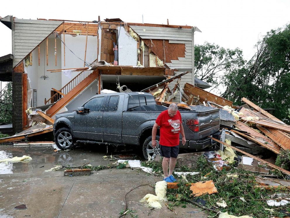 PHOTO: Joe Armison looks over damage to his home after a tornado struck the outskirts of Eudora, Kan., May 28, 2019.