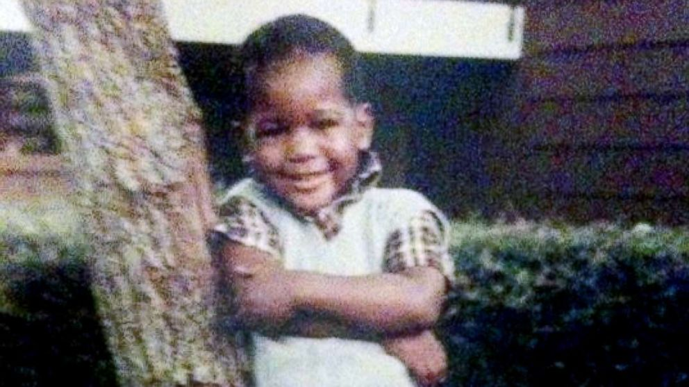 """Young Karamo Brown poses in front of his house. """"I was a very happy child."""""""