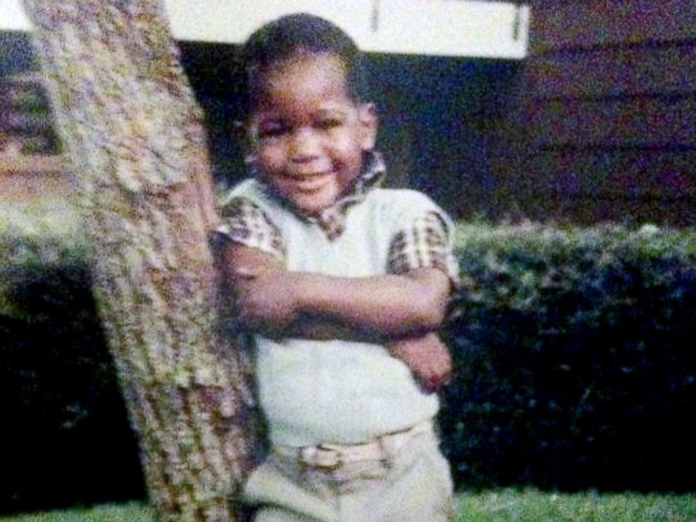 PHOTO: Young Karamo Brown poses in front of his house. I was a very happy child.