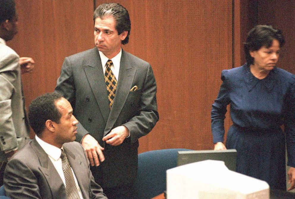 PHOTO: Robert Kardashian stands next to O.J. Simpson as he watches defense witness Rosa Lopez enter the court, Feb. 27, 1995, in Los Angeles.