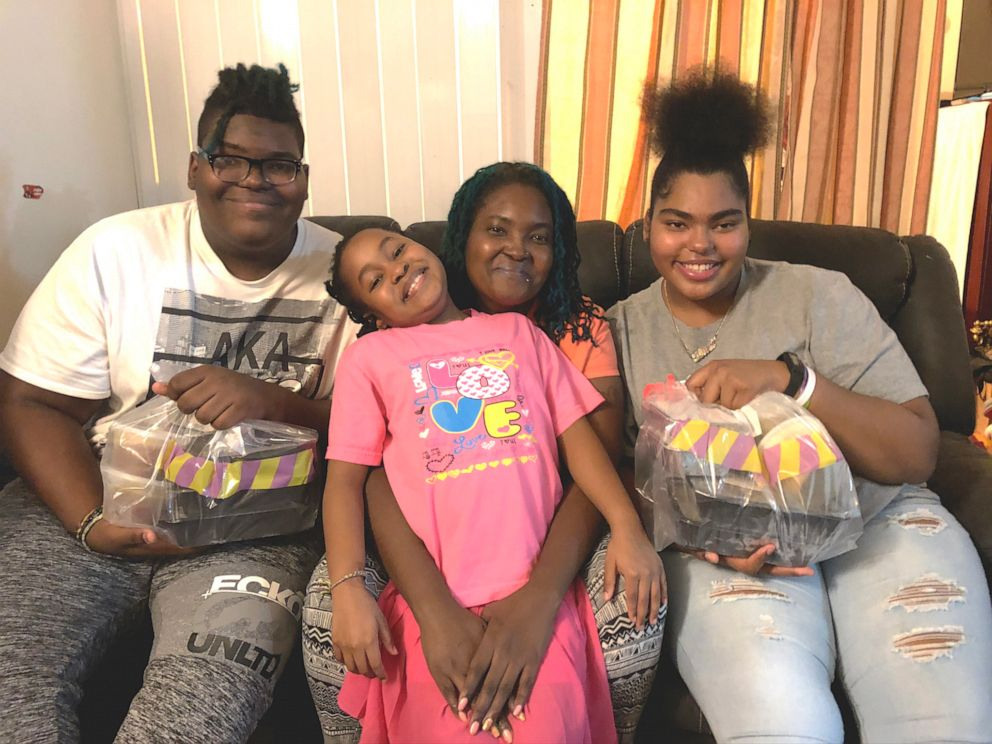 PHOTO: Kareen Gentles, posing with her three children, has been a Gods Love We Deliver client since 2012.