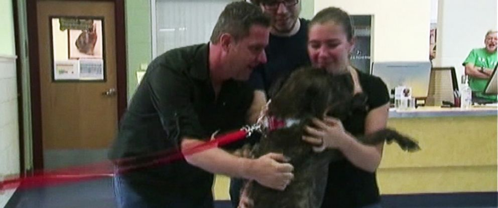 PHOTO: Boozer reunites with his family after going missing nine years ago.