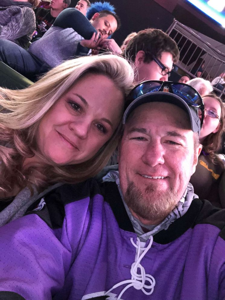 Keith Alexander, 55, and his wife are seen smiling at a hockey game on Jan. 19. The father of four had recently undergone surgery to remove a mass on his colon and will be going under the knife again to remove lesions on his liver.