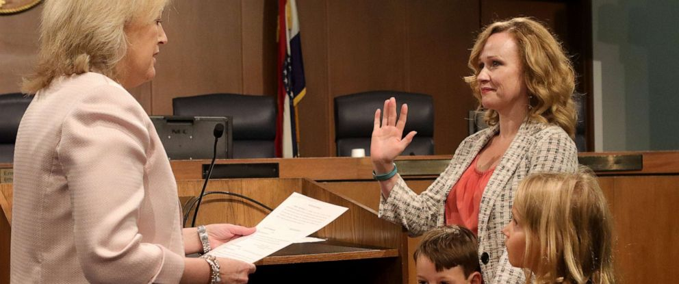 """PHOTO: Kelli Dunaway, right, gets sworn in as a new St. Louis County councilwoman by Diann Valenti, left, acting county council clerk. It is not required to be sworn in on a bible and Dunaway chose to use the Dr. Seuss book, """"Oh, The Places Youll Go!"""""""