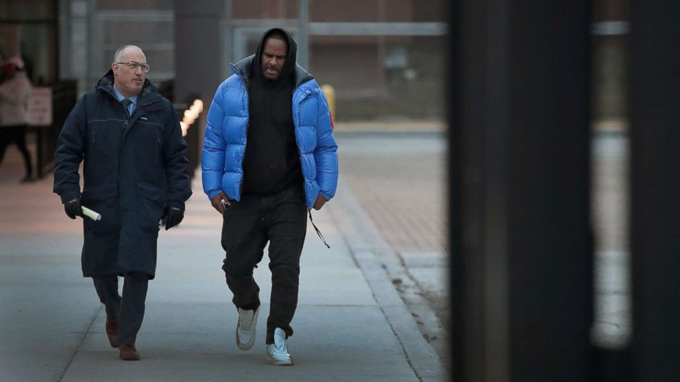 R. Kelly (R) and his attorney Steve Greenberg leave Cook County jail after Kelly posted bond, Feb. 25, 2019, in Chicago.