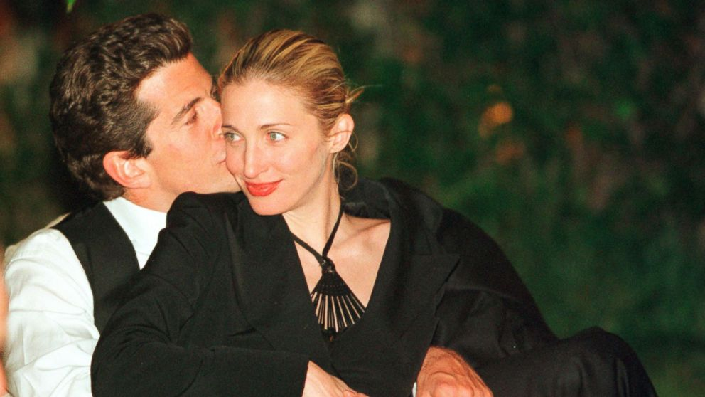 John F. Kennedy, Jr.gives his wife Carolyn a kiss on the cheek during the annual White House Correspondents dinner, May 1, 1999, in Washington, D.C.