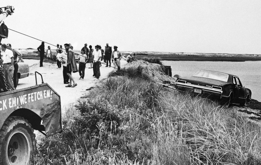PHOTO: A tow truck pulls Senator Edward Kennedys car out of Poucha Pond after the Senators infamous accident on Chappaquiddick Island.