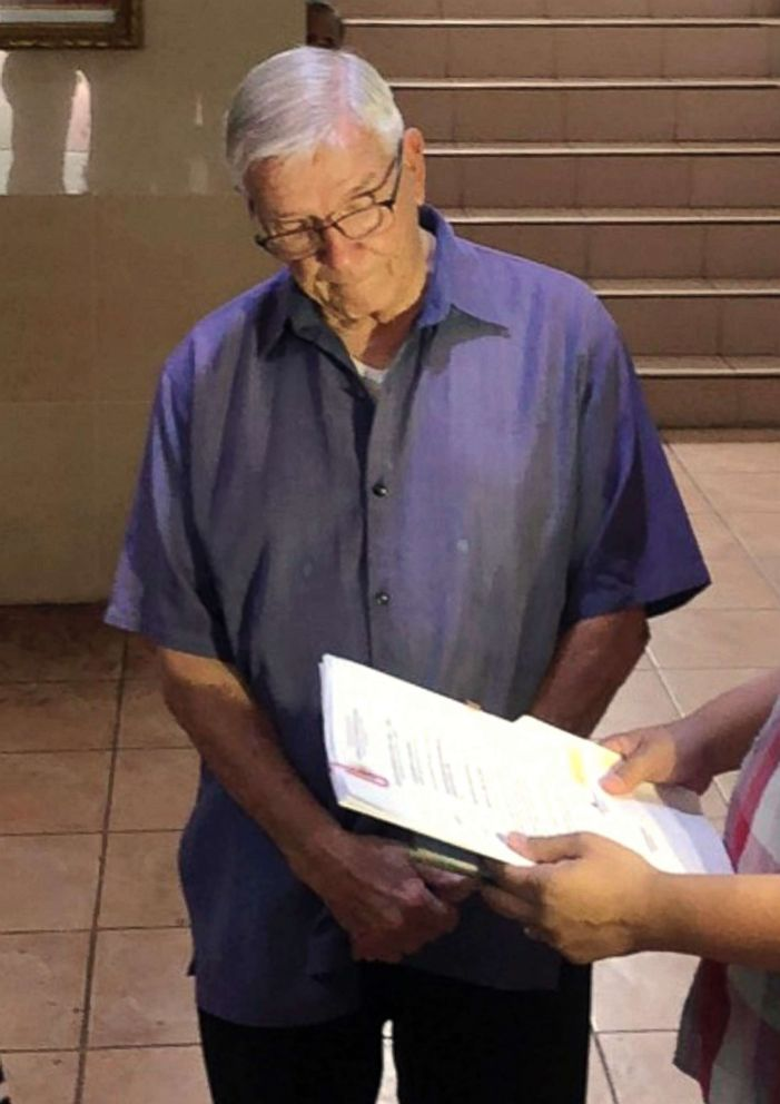PHOTO: In this Dec. 5, 2018, photo American Roman Catholic priest Rev. Kenneth Bernard Hendricks looks at documents after being arrested in a church in Naval town in the island province of Biliran, central Philippines.