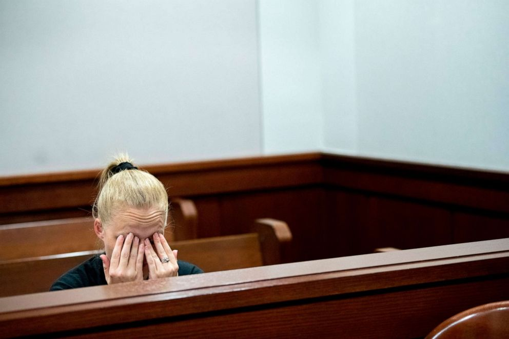 PHOTO: Amiee Cagle, fiancee of 32-year-old Kenneth A. White, wipes her eyes as overcome with emotion as attorneys deliver closing arguments during a juvenile sentencing hearing on June 19, 2019, at Genesee Circuit Court in Flint, Mich.
