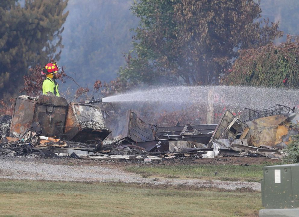 PHOTO: Police and fire officials keep tabs on hot spots and search for victims after a pipeline explosion near a trailer park just south of Danville, Ky., Aug. 1, 2019.