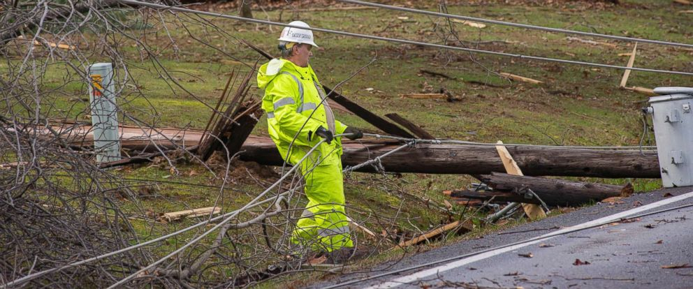 PHOTO: Crews work to clear downed power lines after a storm caused significant damage in the area of West Paducah, Ky., March 14, 2019.