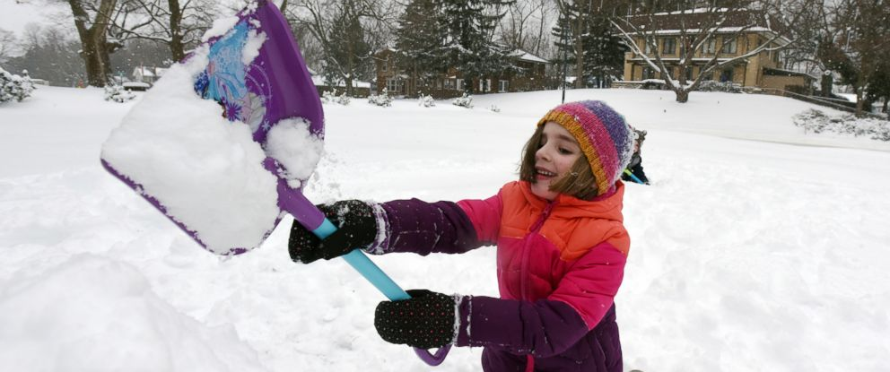 PHOTO: Ainsley Triemstra, 5, builds a snow fort in the front yard of her home in St. Joseph, Mich., on Saturday, Jan. 19, 2019, after a winter storm dumped several inches of snow in Southwest Michigan.