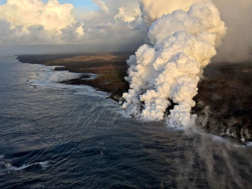 PHOTO: A plume rises where lava pours from the Kilauea Volcano into the sea on the south margin of the fissure 8 flow in Hawaii, July 15, 2018.