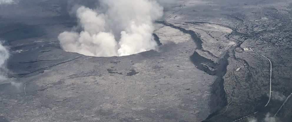 PHOTO: An aerial view of Kilauea Volcanos summit caldera and an ash plume billowing from Halemaumau, a crater within the caldera, in Hawaii, May 27, 2018.