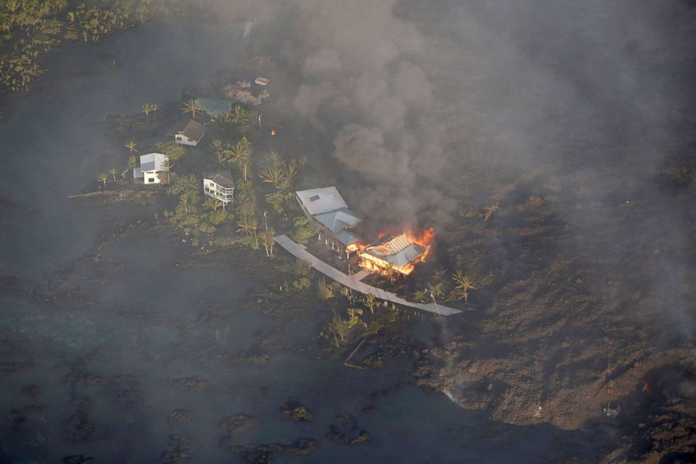 PHOTO: Lava destroys homes in the Kapoho area, east of Pahoa, during ongoing eruptions of the Kilauea Volcano in Hawaii, June 5, 2018.