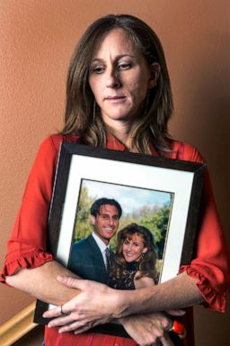 PHOTO: In this May, 15, 2014, file photo, Kim Goldman holds a photo of her with her late brother, Ron Goldman, killed along with his friend Nicole Brown Simpson in 1994, during an interview at her home in Santa Clarita, Calif.