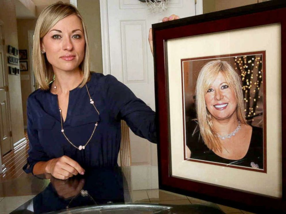 PHOTO: In this May 25, 2016, photo, Kim Pack poses with a photo of her late mother, talk-show host April Kauffman, in Linwood, N.J.