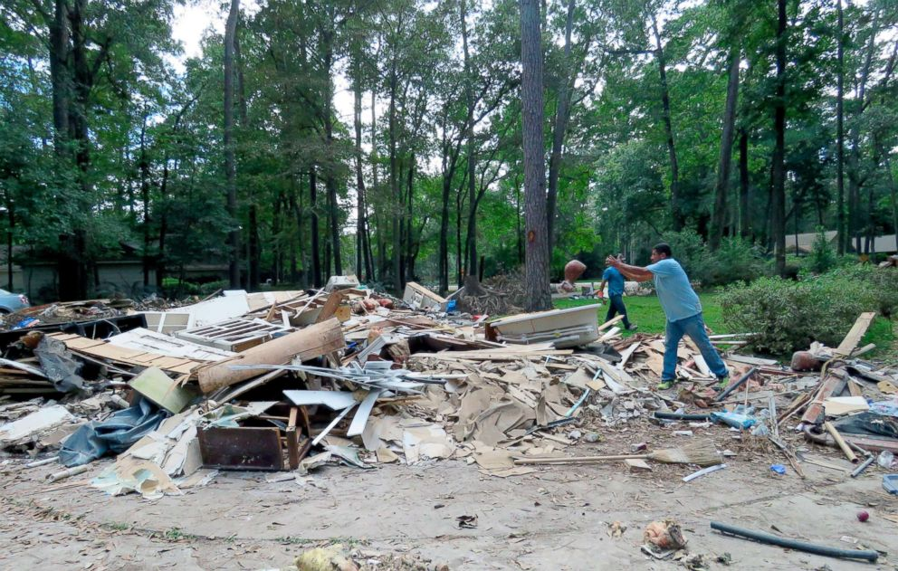 PHOTO: In this Sept. 26, 2017 photo, workers continue clearing debris from the home of Houston resident Chris Slaughter, whose house in the suburb of Kingwood Texas was flooded by 5 1/2 feet of water during Harveys torrential rainfall.