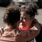 Carmen Gray, left, hugs her sister, Bridget Parkhill, after discussing concerns about coughing exhibited by their mother, Susan Hailey, who is a resident at the Life Care Center of Kirkland, the long-term care facility linked to several confirmed coronavirus cases, in Kirkland, Wash., March 4, 2020.