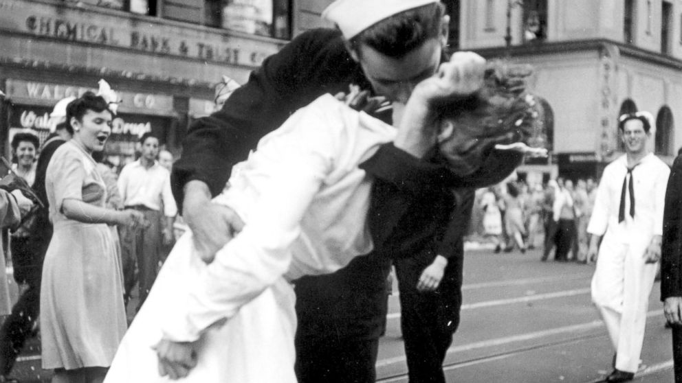A sailor and a woman kiss in New York's Times Square, as people celebrate the end of World War II, Aug. 14, 1945.