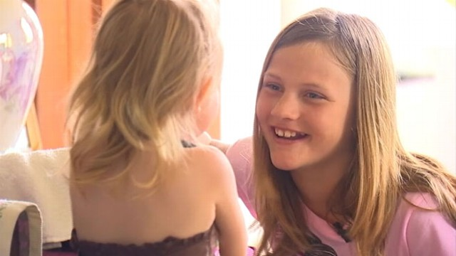 VIDEO: Ryann Raffelson rescued three children trapped inside a Washington state festival attraction.