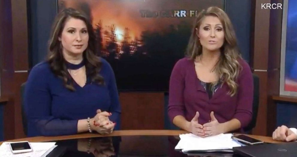 KRCR-TV anchors Tamara Damante and Allison Woods were forced to evacuate the news station while reporting on the Carr Fire in Redding, Calif., July 26, 2018.