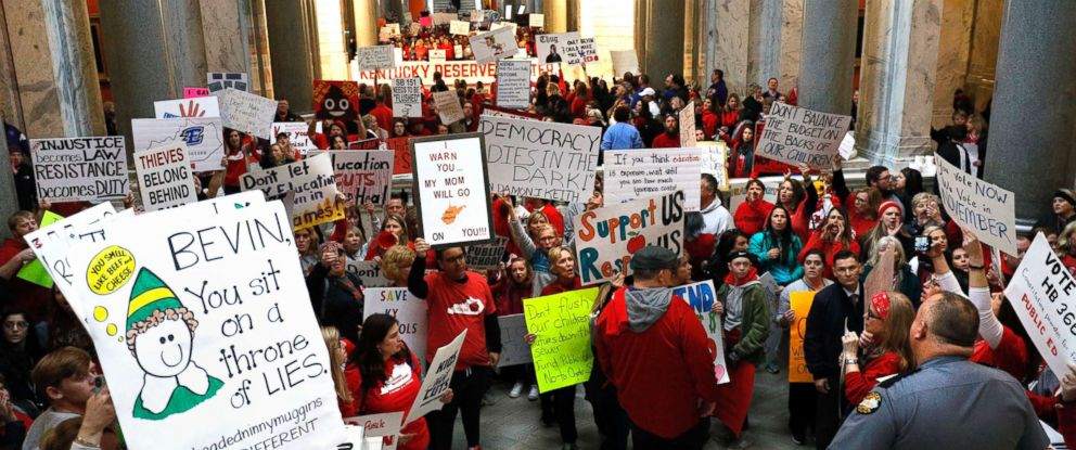 PHOTO: Public school teachers and their supporters protest against a pension reform bill outside the senate chambers at the Kentucky State Capital, April 2, 2018 in Frankfort, Ky.