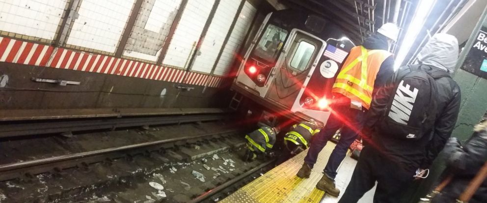PHOTO: Firefighters work at the scene where a woman fell onto the subway tracks at the Bedford Ave. L train stop in Brooklyn, NY, Jan. 11, 2018.