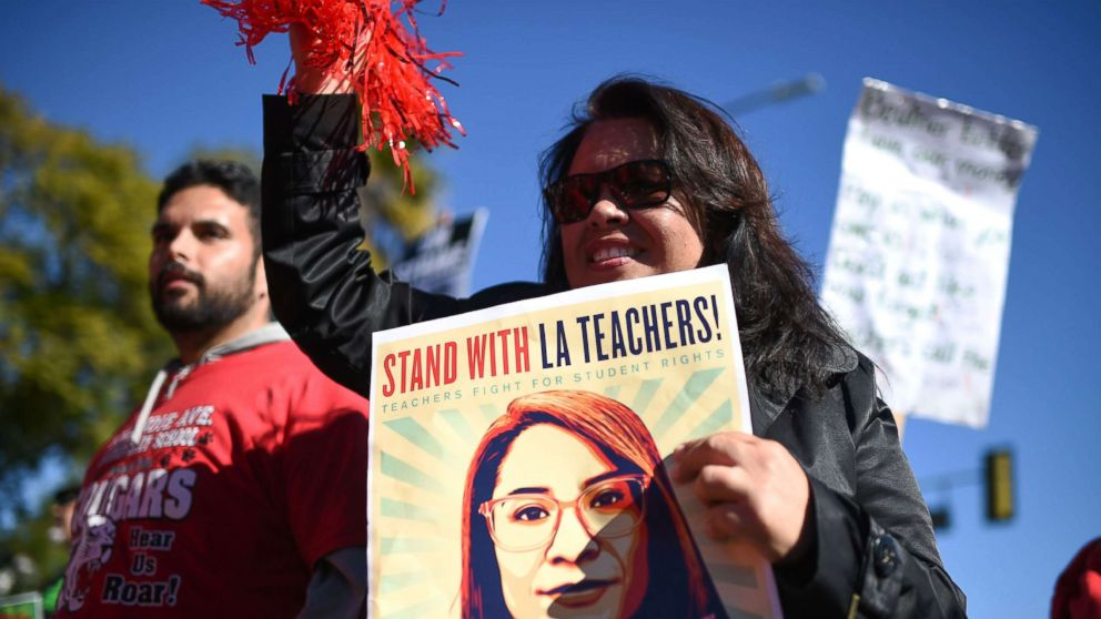Striking public school teachers and their supporters march during the 34th annual Kingdom Day Parade on Martin Luther King Jr Day, Jan. 21, 2019, in Los Angeles.
