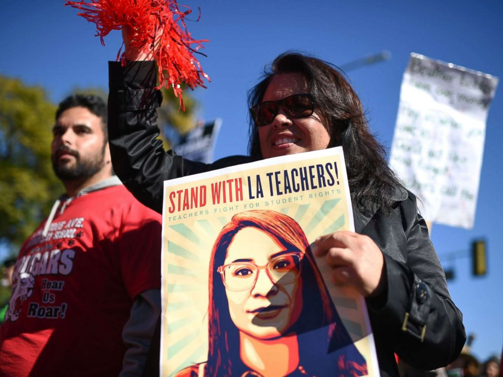 PHOTO: Striking public school teachers and their supporters march during the 34th annual Kingdom Day Parade on Martin Luther King Jr Day, Jan. 21, 2019, in Los Angeles.