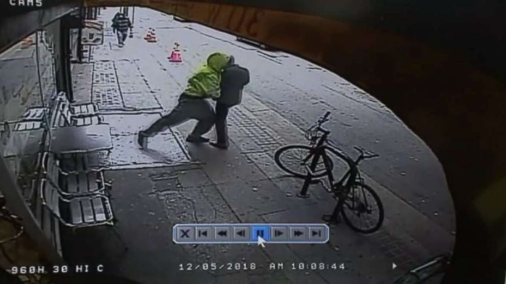 0009384a1bb9c Surveillance video shows a man pushing a random passerby in front of a  truck in downtown