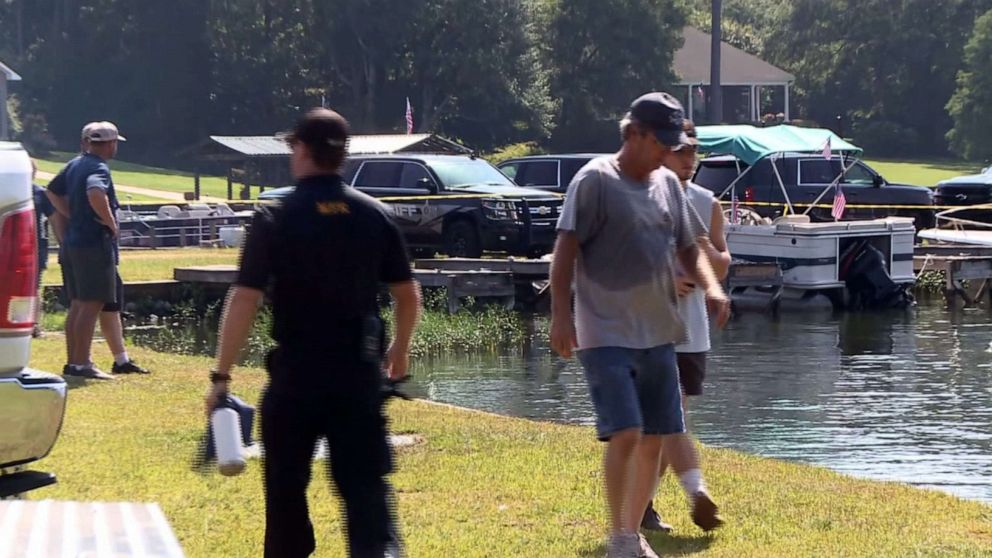 PHOTO: Police and boat rescue teams work at Lake Jordan in Alabama after reports that two people went missing after a boat crash late on July 4, 2019.