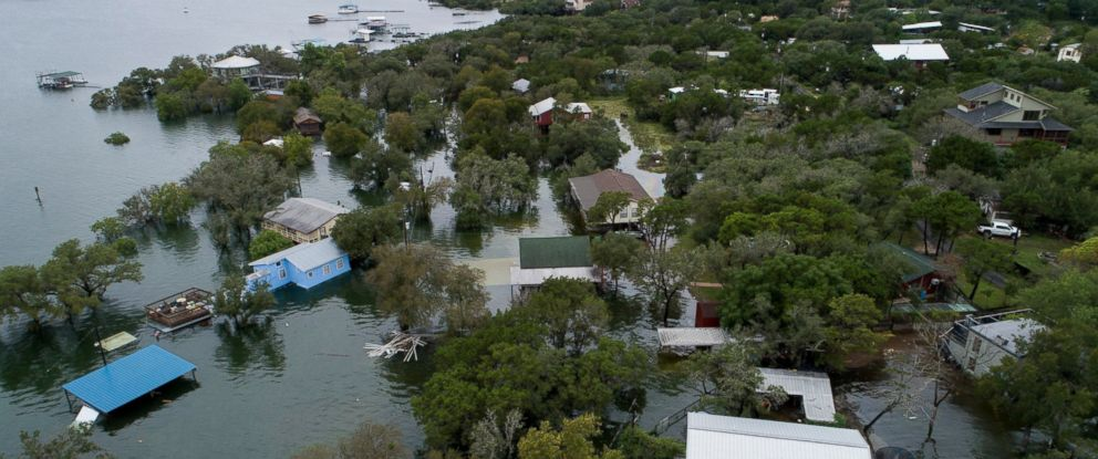 PHOTO: Houses are flooded at Graveyard Point on Lake Travis Wednesday, Oct. 17, 2018, in Austin, Texas.