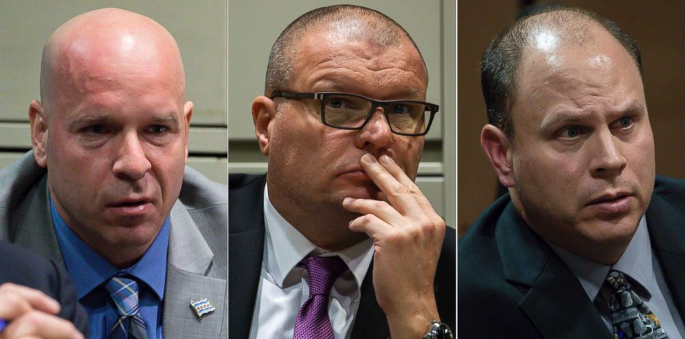 This combination of Nov. 28, 2018 file photos shows former Chicago Police officer Joseph Walsh, left, former detective David March and former officer Thomas Gaffney, accused of trying to cover up the fatal shooting of Laquan McDonald,  during a bench trial before Judge Domenica A. Stephenson at Leighton Criminal Court Building in Chicago.