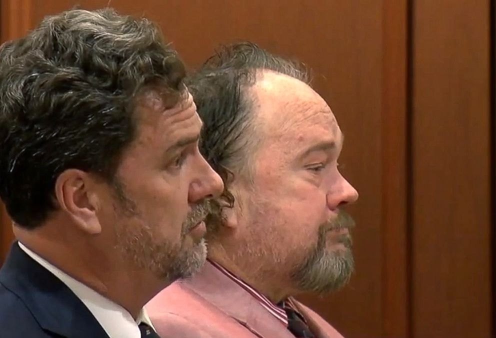PHOTO: Former Detective Troy Allen Large, right, with his lawyer during a court appearance before his death in January 2018.