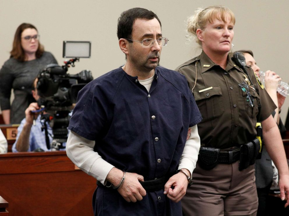 PHOTO: Larry Nassar, a former team USA Gymnastics doctor, who pleaded guilty in Nov. 2017 to sexual assault charges, is led from the courtroom after listening to victim testimony during his sentencing hearing in Lansing, Mich., Jan. 23, 2018.