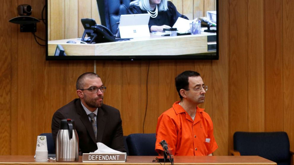 Defendant Larry Nassar and his defense attorney Matt Newburg listen to Judge Janice Cunningham hand down his prison sentence during the sentencing hearing of Nassar in Charlotte, Michigan, Feb. 5, 2018.