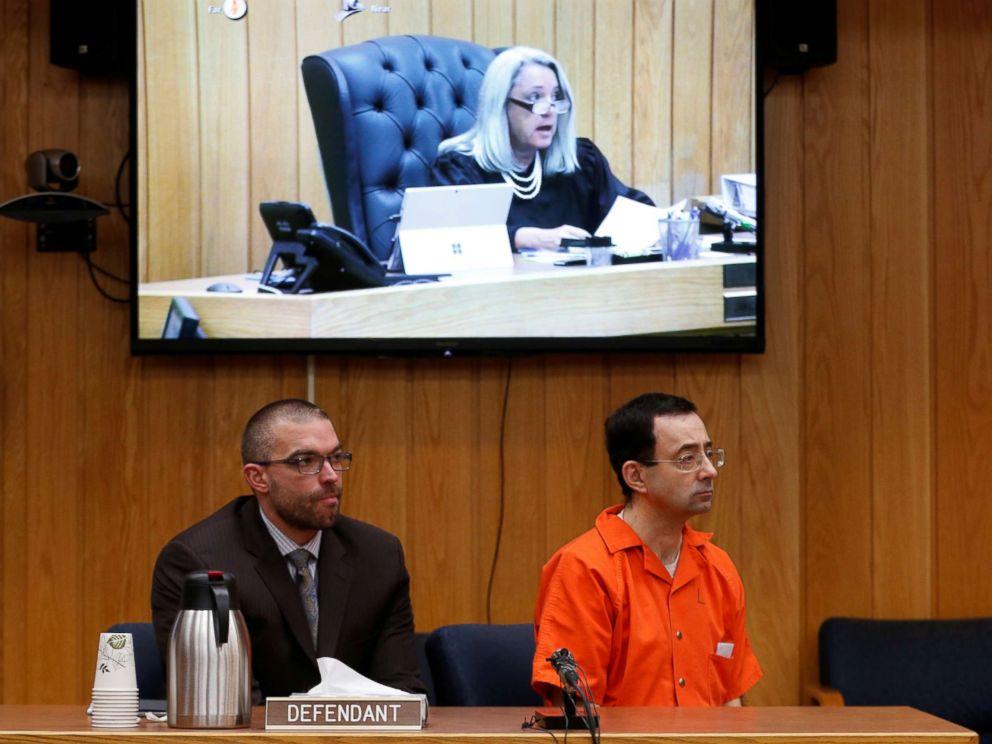 PHOTO: Defendant Larry Nassar and his defense attorney Matt Newburg listen to Judge Janice Cunningham hand down his prison sentence during the sentencing hearing of Nassar in Charlotte, Michigan, Feb. 5, 2018.