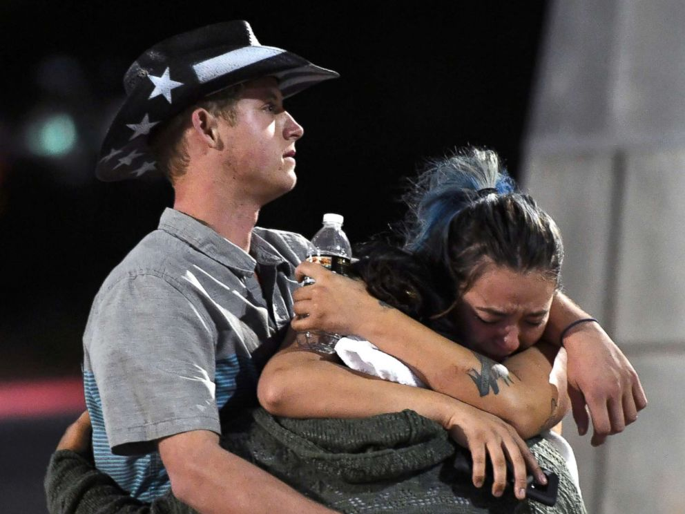 PHOTO: People hug and cry outside the Thomas & Mack Center after a mass shooting at the Route 91 Harvest country music festival, Oct. 2, 2017 in Las Vegas, Nevada.