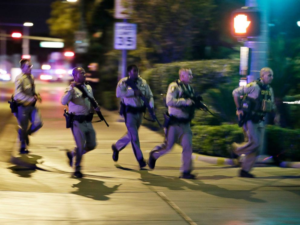 PHOTO: Police run at the scene of a shooting near the Mandalay Bay resort and casino on the Las Vegas Strip, Oct. 1, 2017, in Las Vegas.   911 calls from Las Vegas shooting reveals chaos, panic that ensued as gunman opened fire las vegas cops running ap ps 171002 4x3 992