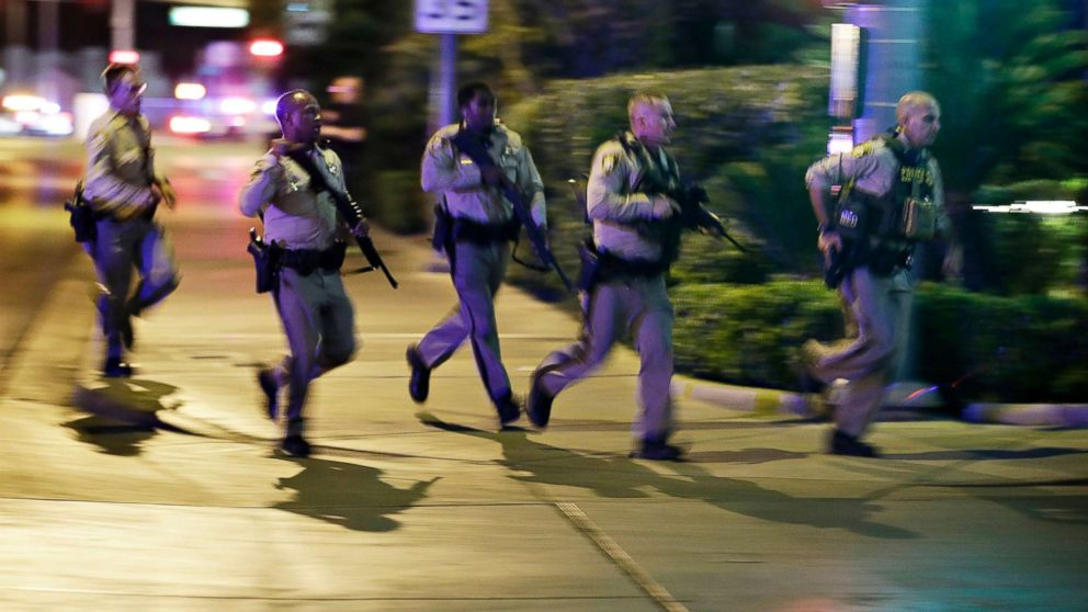 Police run at the scene of a shooting near the Mandalay Bay resort and casino on the Las Vegas Strip, Oct. 1, 2017, in Las Vegas.
