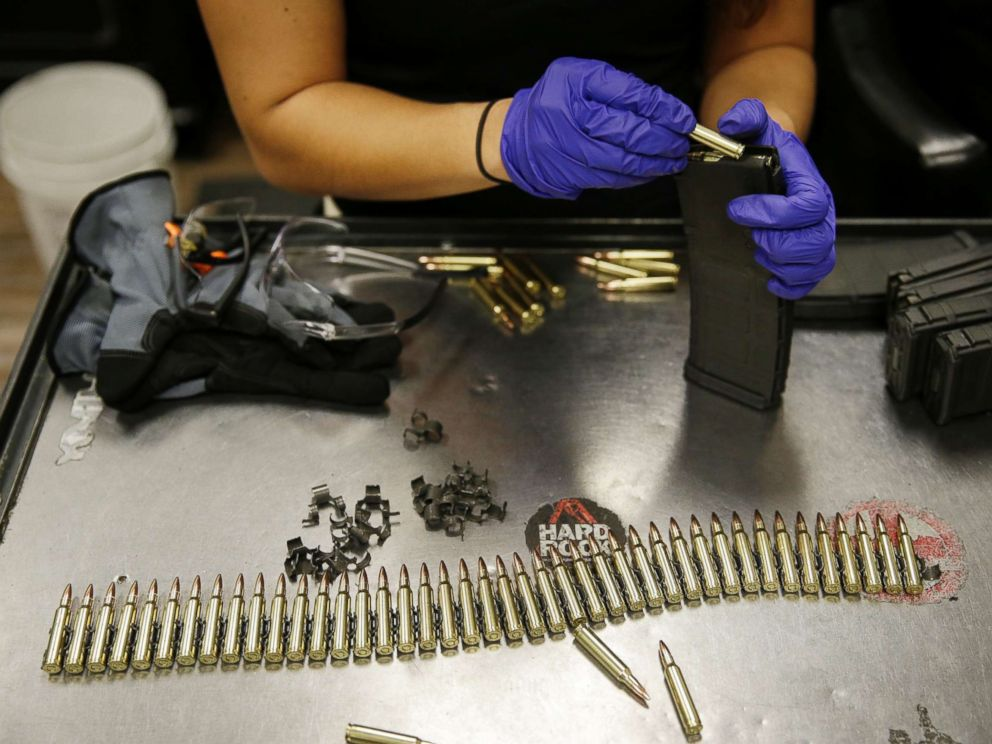PHOTO: An employee loads up a magazine for an automatic machine gun at Machine Guns Vegas, Aug. 28, 2014, in Las Vegas.