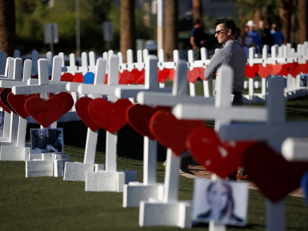PHOTO: A man looks at the 58 white crosses set up for the victims of the Route 91 music festival mass shooting in Las Vegas, Oct. 5, 2017.