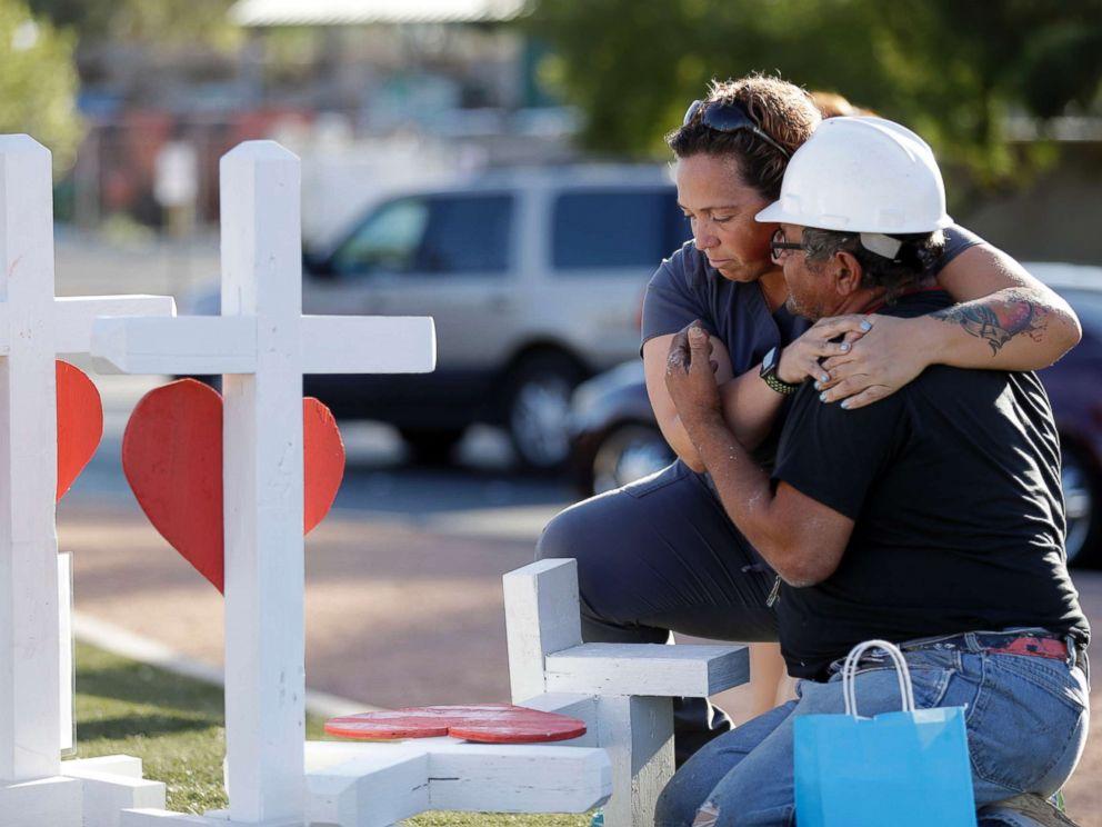 PHOTO: Ebony Saunders, left, hugs Greg Zanis in front of his memorial crosses, Oct. 5, 2017, in Las Vegas.