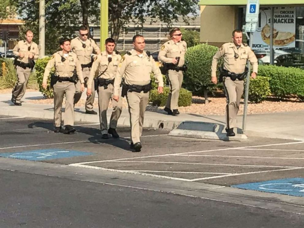 Police officers respond to a shooting at a Ross Dress for Less store in Las Vegas on Saturday, Aug. 11, 2018.