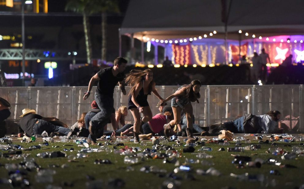 People run from the Route 91 Harvest country music festival after gun fire was heard on Oct. 1, 2017, in Las Vegas.