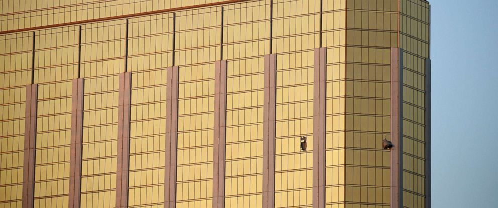 PHOTO: Drapes billow out of broken windows at the Mandalay Bay Resort and Casino, Oct. 2, 2017, on the Las Vegas Strip.