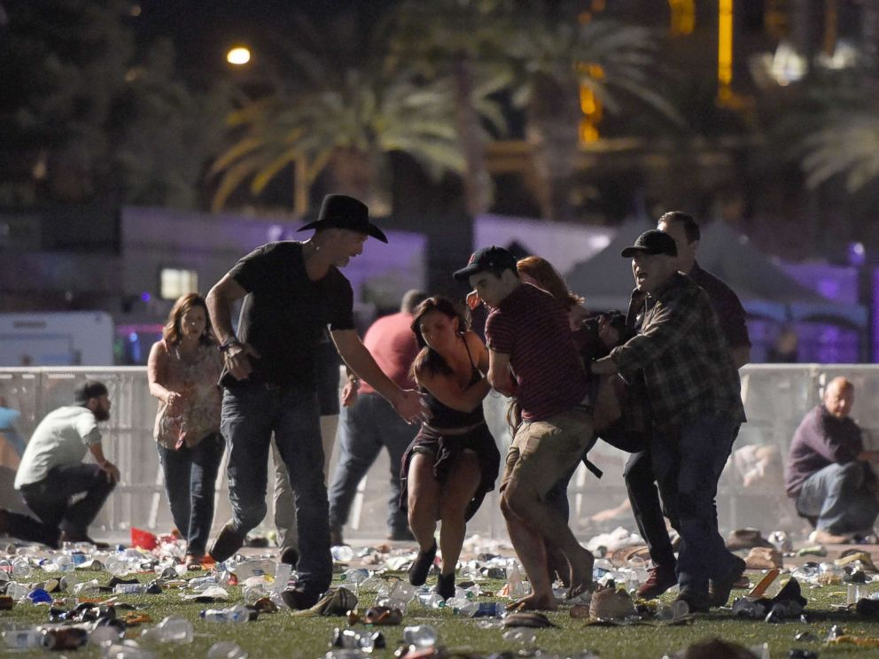 PHOTO: People carry a an injured person at the Route 91 Harvest country music festival after gun fire was heard, Oct. 1, 2017 in Las Vegas.