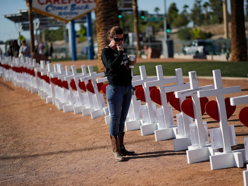 PHOTO: Jill Hale stands at a makeshift memorial for shooting victims, Tuesday, Oct. 1, 2019, in Las Vegas, on the anniversary of the mass shooting two years earlier.