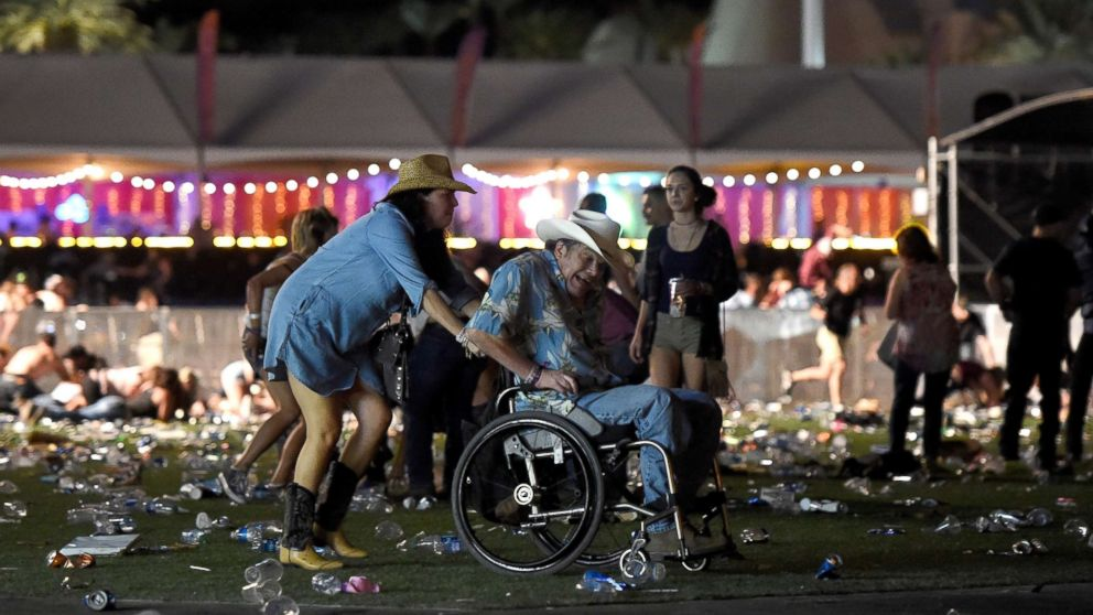 A man in a wheelchair is taken away from the Route 91 Harvest country music festival after gun fire was heard, Oct. 1, 2017 in Las Vegas.